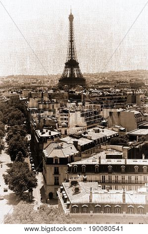 France. Paris. View of openwork Eiffel tower in style old shabby photos.