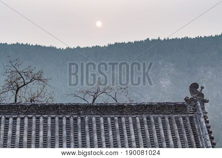 Sun Over Roof Of Pagoda On East Hill In Longmen