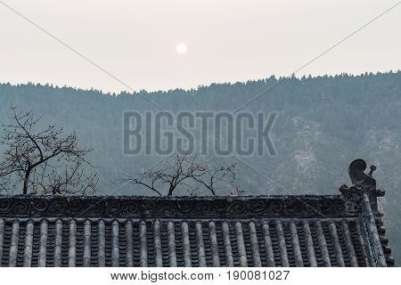 Sun Over Roof Of Temple On East Hill In Longmen