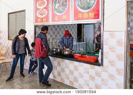 People In Cheap Urban Eatery In Longsheng Town
