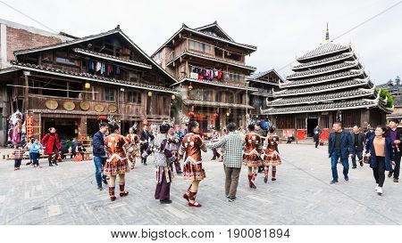 Tourists And Round Dance On Square In Chengyang