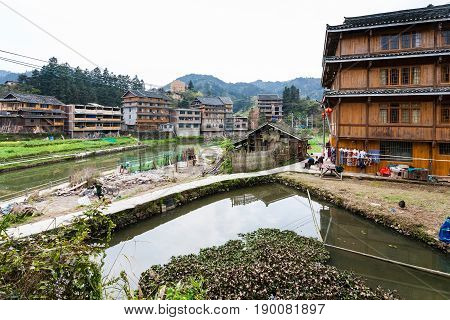 People On Backyard Of Country House In Chengyang