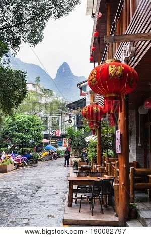 People And Eatery On Alley In Yangshuo Town