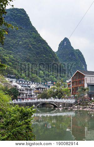 Mountain Over Bridge In Yangshuo Town In Spring