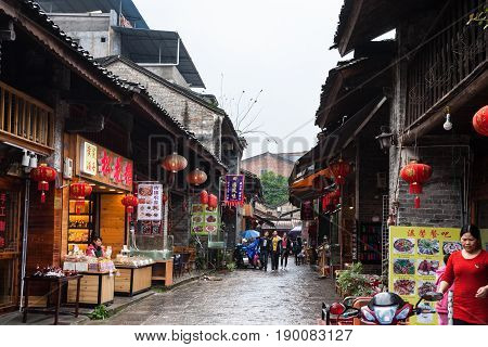 People On Eatery Street In Xingping Town