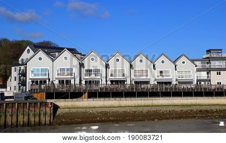 Wadebridge, Cornwall, Uk - April 6Th 2017: Row Of Modern Riverside Apartments Next To The River Came