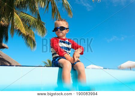 happy little boy having fun at pool, vacation concept