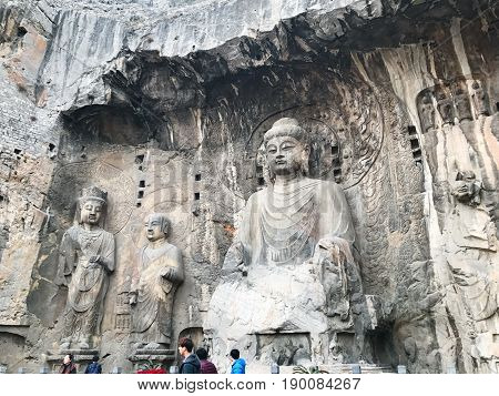 People Near The Big Vairocana Statue In Grotto