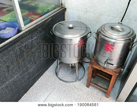 Tanks With Hot Chicken Broth And Boiling Water