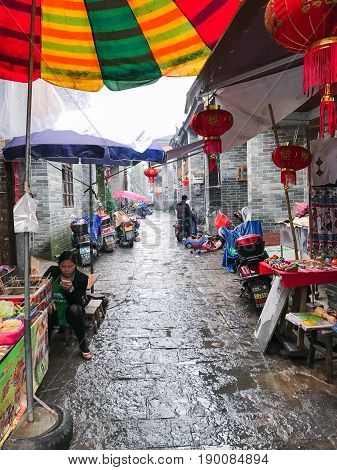 Sellers And Stalls On Street Market In Xingping