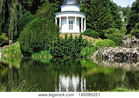 Wonderful picturesque small lake in front of the Castle Wilhelmshoehe Kassel, Hesse, Germany