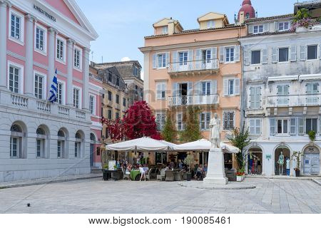 KERKYRA, GREECE - MAY 23: Tourists in cafes in front of town hall on May 23, 2017 in Kerkyra, Corfu island in Greece.