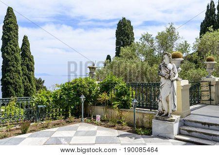 GASTOURI, GREECE - MAY 15: Statue of god Apollo in Achilleion palace on May 15, 2017 in Gastouri, Corfu island in Greece. Achilleion was the palace of empress Elisabeth of Austria, also known as Sisi.