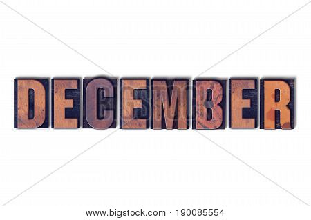 The word December concept and theme written in vintage wooden letterpress type on a white background.