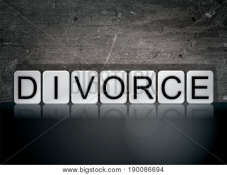 The word Divorce concept and theme written in 3D white tiles on a dark background.