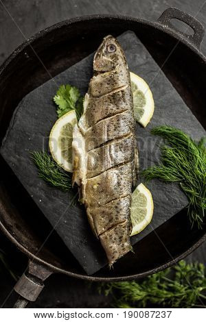 Baked rainbow trout fish with dill and lemon. Restaurant. Seafood
