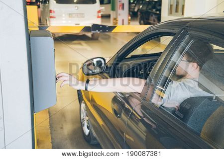 man going to parking taking ticket in passcontrol