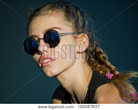 Woman With Pretty Face And Plaits In Stylish Sunglasses