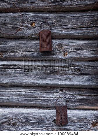 natural aged old rusted grater on the wooden wall