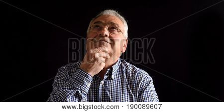 the Pensative man on a  black background