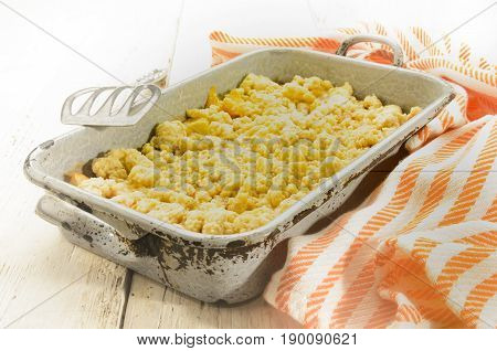 british apple crumble in an old baking tray