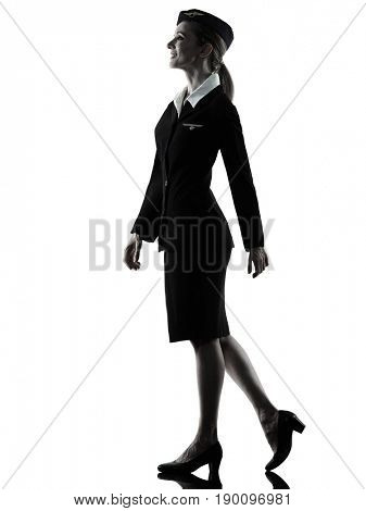 one caucasian Stewardess cabin crew  woman walking isolated on white background in  silhouette