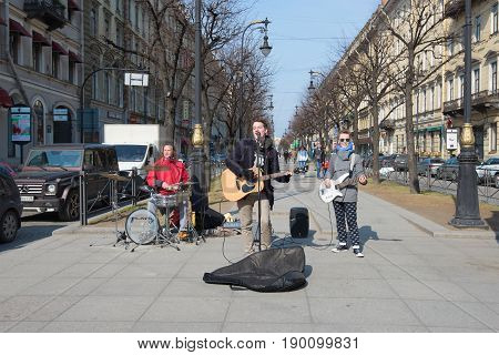 ST. PETERSBURG, RUSSIA - APRIL 10, 2017: Young street musicians play on Bolshaya Konyushennaya Street in the sunny April afternoon