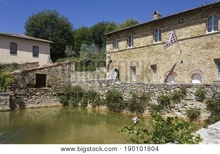 BAGNO VIGNONI, ITALY - JUNE 3 2017: the small medieval town of Bagno Vignoni in Italy with its hot spring thermal bath