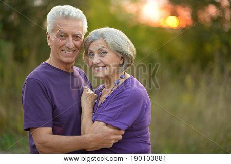 Portrait of a happy senior couple resting outdoors