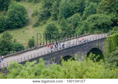 Derbyshire, UK - July 20 2014 - Monsal Dale Viaduct on the River Wye on 20 July at Monsal Dale, Peak District, UK