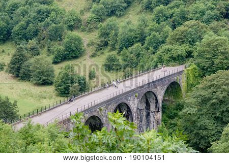 Derbyshire UK - July 20 2014 - Monsal Dale Viaduct on the River Wye on 20 July at Monsal Dale Peak District UK