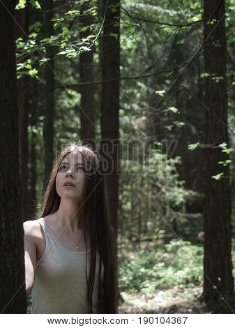 Portrait of romantic woman in forest. Innocence.