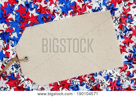 Patriotic USA red white and blue stars with gift tag background with copy space for your message