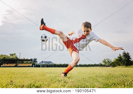 8 Years Old Boy Child Playing Football And Rolls Over