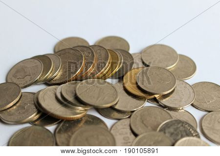 Pile of coins on white background Selective focus