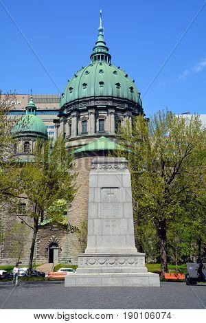 MONTREAL QUEBEC CANADA 05 17 2017: World Wars & Korean War Memorial at Place du Canada in Montreal, Quebec, Canada.