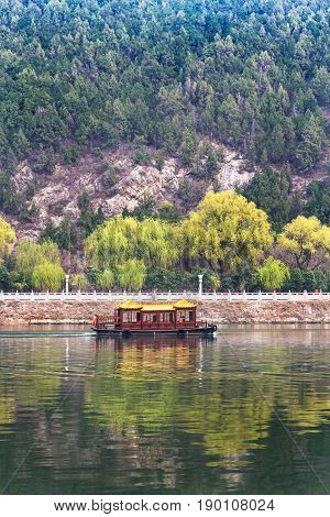 View Of Boat In Yi River And Green East Hill