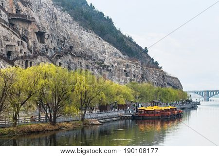 View Of Carved West Hill With Longmen Grottoes