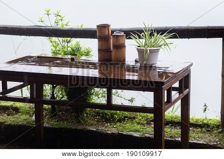Wet Table On Terrace In Village In Spring Rain