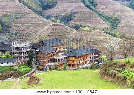 View Of Houses In Village Between Terraced Hills