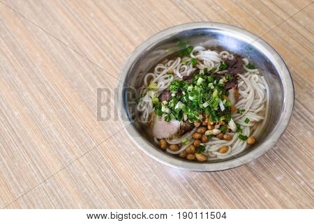 Dish With Udon Noodles Soup With Pork In Eatery