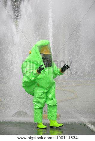 Man With A Green Protective Suit Against Radiation And Chemical