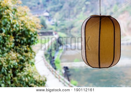 Chinese Lantern And Unfocused Irrigation Canal