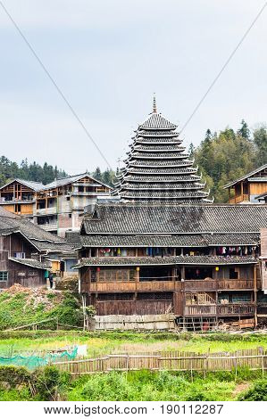 Tower And Wooden Houses In Chengyang Village