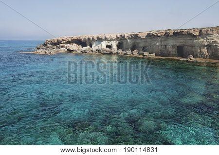 Sea caves of Cavo greco cape. Ayia napa Cyprus. Mediterranean sea landscape