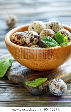 Quail Eggs And Mint Leaves In A Bowl.