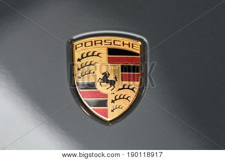 Krakow Poland May 21 2017: Porsche Stuttgart sign close-up during MotoShow in Krakow. Porsche is a famous German automobile manufacturer.