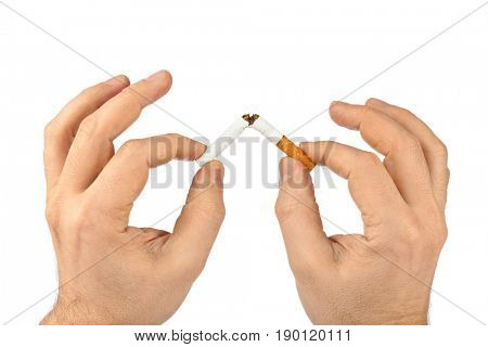 Broken cigarette in hands isolated on white background