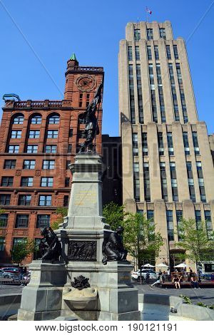 MONTREAL CANADA 05 17 17: Place d'Armes is a square in Old Montreal quarter. In the center, there is a monument in memory of Paul de Chomedey founder of Montreal.  Quebec Canada.