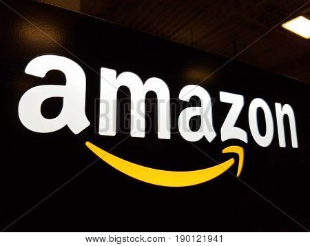 HONOLULU - JANUARY 12 2017: Amazon logo on black shiny wall in Honolulu Best Buy store on January 12 2017. Amazon is an American international electronic commerce company. It is the world's largest online retailer.